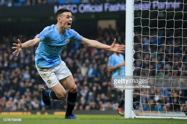 Phil Foden of Man City celebrates after scoring their 2nd goal during the FA Cup Third Round match between Manchester City and Rotherham United at...