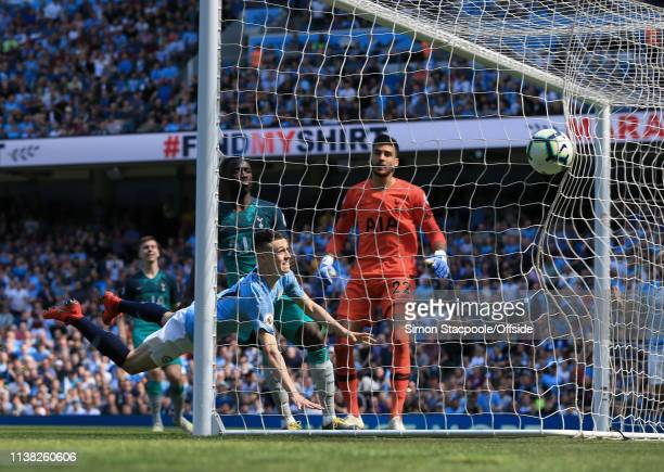 Phil Foden of Man City scores their 1st goal during the Premier League match between Manchester City and Tottenham Hotspur at the Etihad Stadium on...