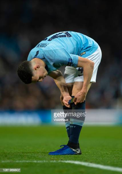 Phil Foden of Manchester City adjusts his socks during the UEFA Champions League Group F match between Manchester City and TSG 1899 Hoffenheim at...