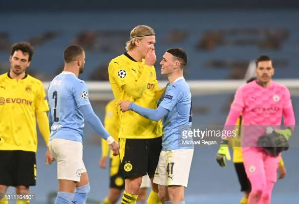 Phil Foden of Manchester City and Erling Haaland of Borussia Dortmund interact following the UEFA Champions League Quarter Final match between...