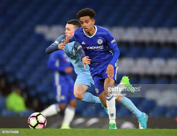 Phil Foden of Manchester City and Jacob Maddox of Chelsea in action during the FA Youth Cup Final second leg between Chelsea and Mancherster City at...