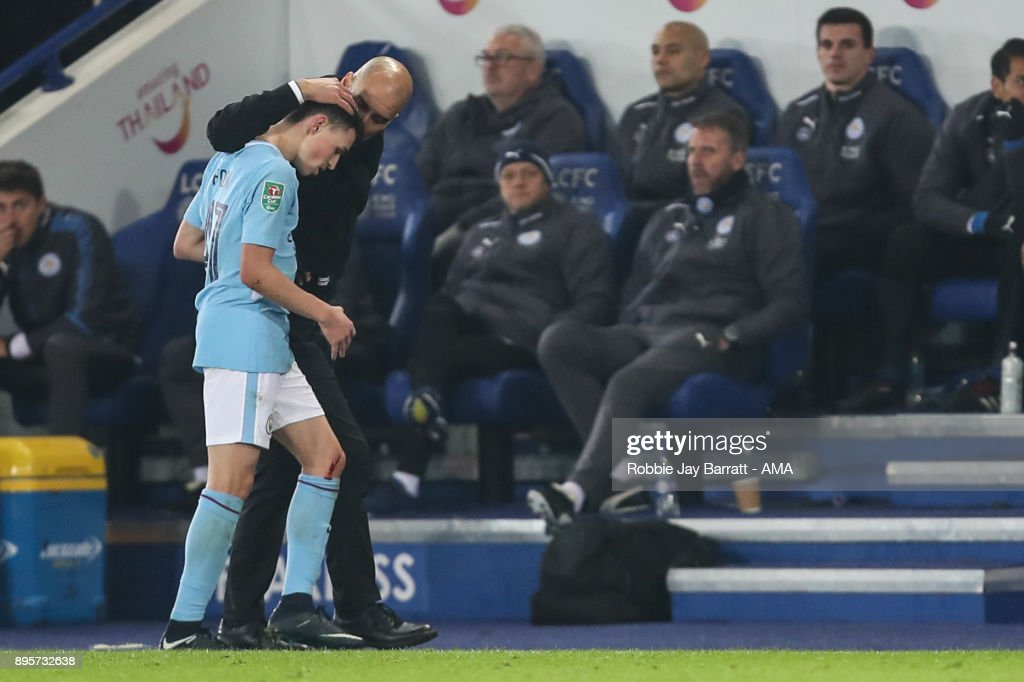 https://media.gettyimages.com/photos/phil-foden-of-manchester-city-and-pep-guardiola-the-head-coach-of-picture-id895732638