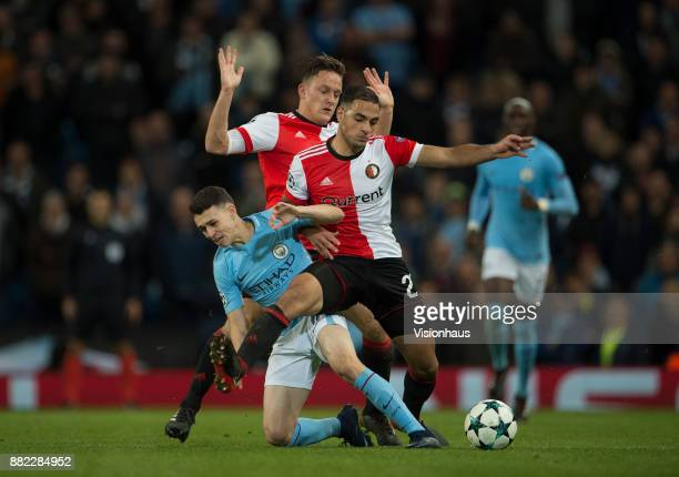 Phil Foden of Manchester City and Sofyan Amrabat of Feyenoord during the UEFA Champions League group F match between Manchester City and Feyenoord at...