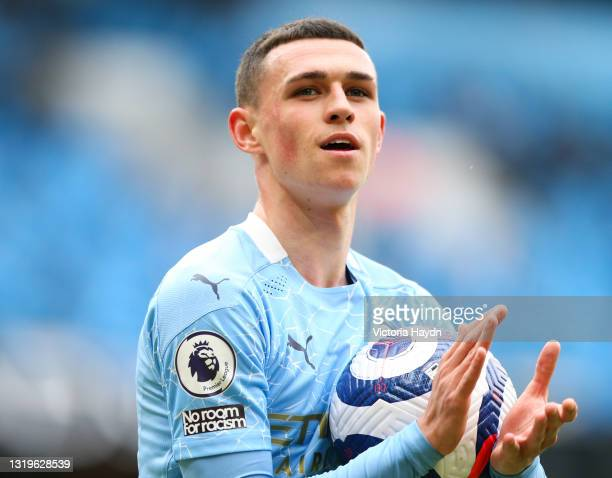 Phil Foden of Manchester City applauds fans during the Premier League match between Manchester City and Everton at Etihad Stadium on May 23, 2021 in...