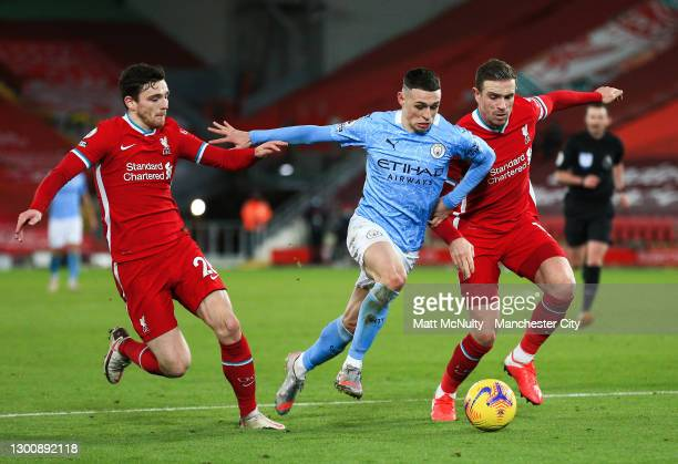 Phil Foden of Manchester City attacks during the Premier League match between Liverpool and Manchester City at Anfield on February 07, 2021 in...