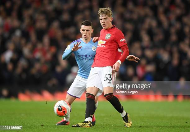 Phil Foden of Manchester City battles for possession with Brandon Williams of Manchester United during the Premier League match between Manchester...