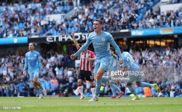 Phil Foden of Manchester City celebrates a goal which is later disallowed for offside following a VAR review during the Premier League match between...
