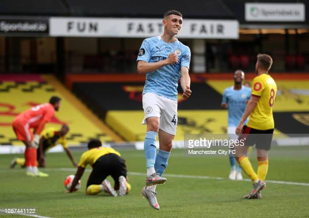 Phil Foden of Manchester City celebrates after he scores his teams third goal during the Premier League match between Watford FC and Manchester City...