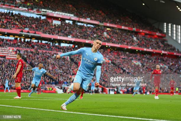 Phil Foden of Manchester City celebrates after scoring a goal to make it 1-1 during the Premier League match between Liverpool and Manchester City at...