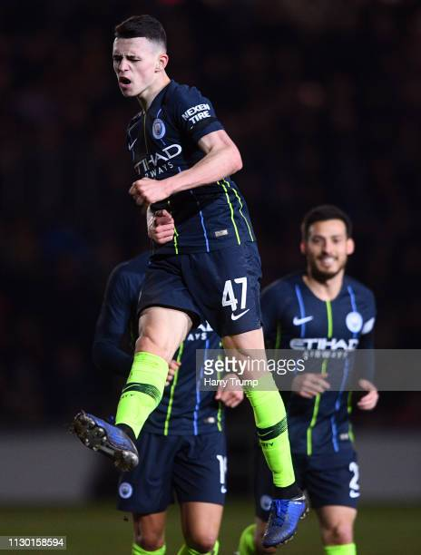 Phil Foden of Manchester City celebrates after scoring his sides third goal during the FA Cup Fifth Round match between Newport County AFC and...