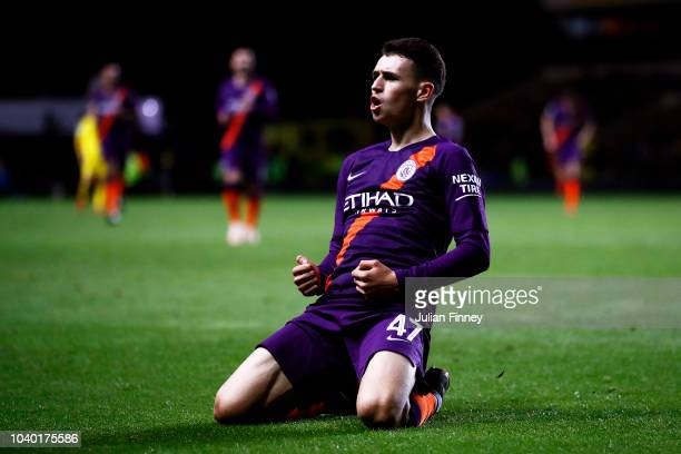 Phil Foden of Manchester City celebrates after scoring his team's third goal during the Carabao Cup Third Round match between Oxford United and...