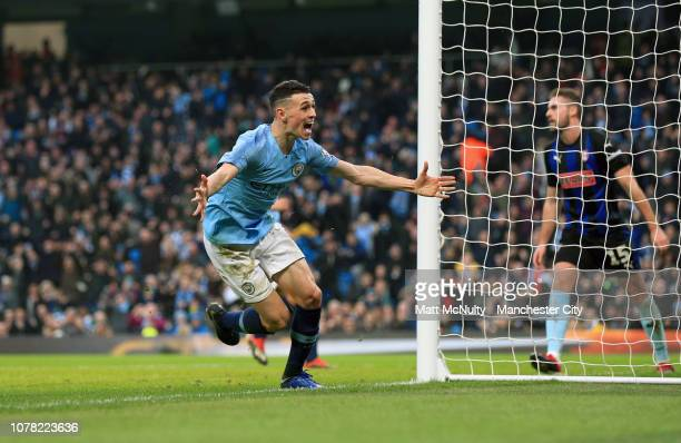 Phil Foden of Manchester City celebrates after scoring his team's second goal during the FA Cup Third Round match between Manchester City and...