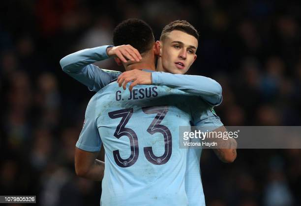 Phil Foden of Manchester City celebrates after scoring his team's sixth goal with team mate Gabriel Jesus during the Carabao Cup Semi Final First Leg...