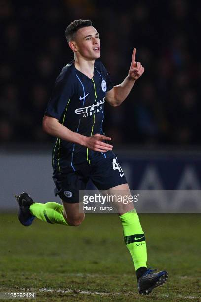 Phil Foden of Manchester City celebrates after scoring his team's second goal during the FA Cup Fifth Round match between Newport County AFC and...