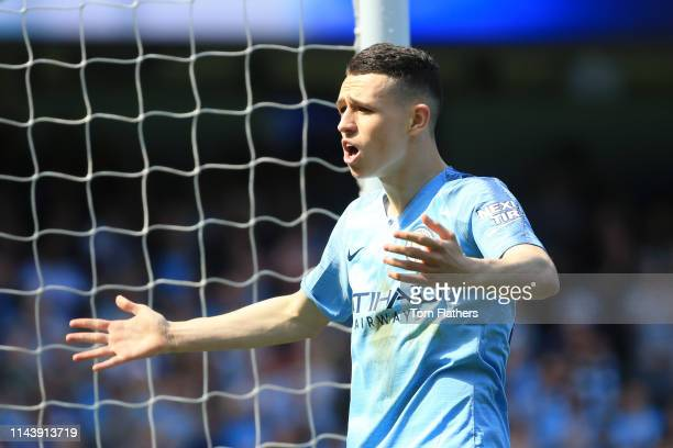Phil Foden of Manchester City celebrates after scoring his team's first goal during the Premier League match between Manchester City and Tottenham...