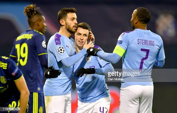 Phil Foden of Manchester City celebrates after scoring his team's fourth goal with Bernardo Silva and Raheem Sterling during the UEFA Champions...