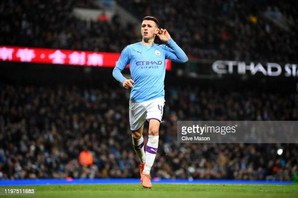 Phil Foden of Manchester City celebrates after scoring his team's fourth goal during the FA Cup Third Round match between Manchester City and Port...