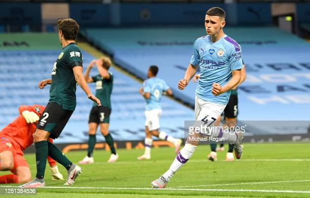 Phil Foden of Manchester City celebrates after scoring his teams fifth during the Premier League match between Manchester City and Burnley FC at...