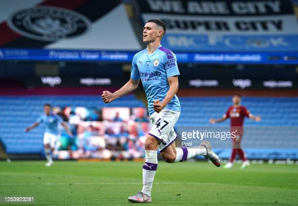Phil Foden of Manchester City celebrates after scoring his team's third goal during the Premier League match between Manchester City and Liverpool FC...