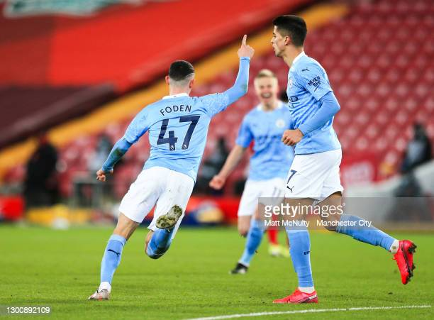 Phil Foden of Manchester City celebrates after scoring his teams fourth goal during the Premier League match between Liverpool and Manchester City at...