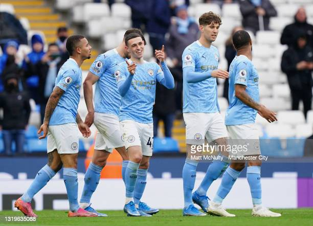 Phil Foden of Manchester City celebrates after scoring his team's third goal during the Premier League match between Manchester City and Everton at...
