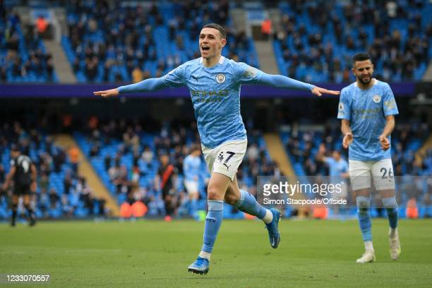 Phil Foden of Manchester City celebrates after scoring their 3rd goal during the Premier League match between Manchester City and Everton at Etihad...