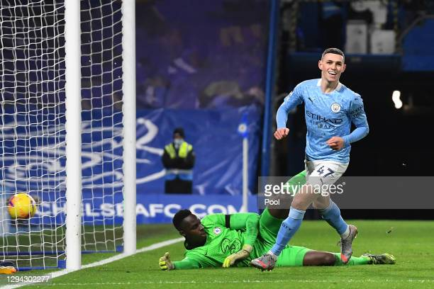 Phil Foden of Manchester City celebrates after scoring their sides second goal as Edouard Mendy of Chelsea looks dejected during the Premier League...