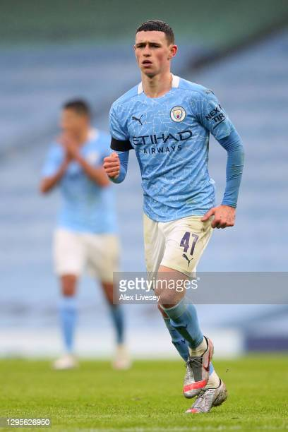 Phil Foden of Manchester City celebrates after scoring their side's third goal during the FA Cup Third Round match between Manchester City and...
