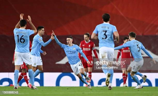 Phil Foden of Manchester City celebrates after scoring their side's fourth goal during the Premier League match between Liverpool and Manchester City...