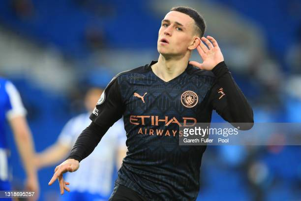 Phil Foden of Manchester City celebrates after scoring their side's second goal during the Premier League match between Brighton & Hove Albion and...
