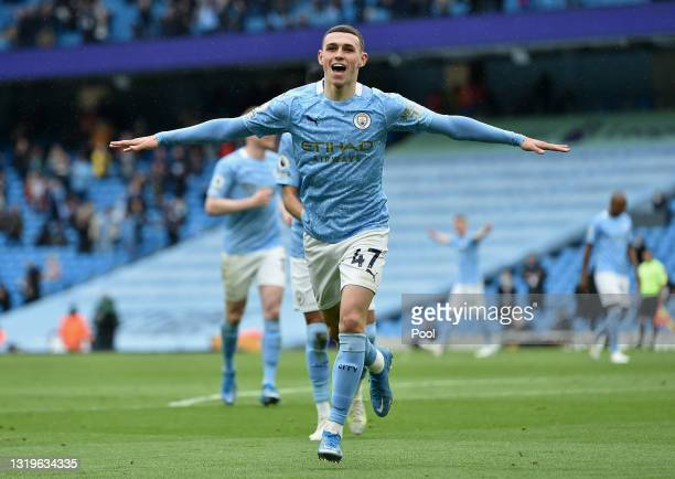 Phil Foden of Manchester City celebrates after scoring their side's third goal during the Premier League match between Manchester City and Everton at...