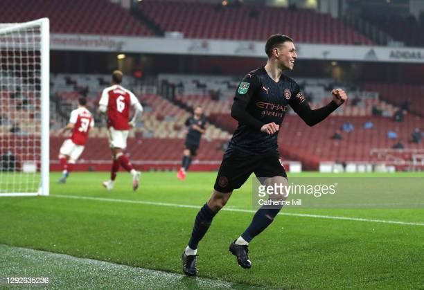 Phil Foden of Manchester City celebrates after scoring their team's third goal during the Carabao Cup Quarter Final match between Arsenal and...