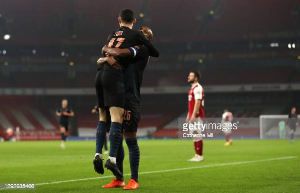 Phil Foden of Manchester City celebrates after scoring their team's third goal with Fernandinho during the Carabao Cup Quarter Final match between...