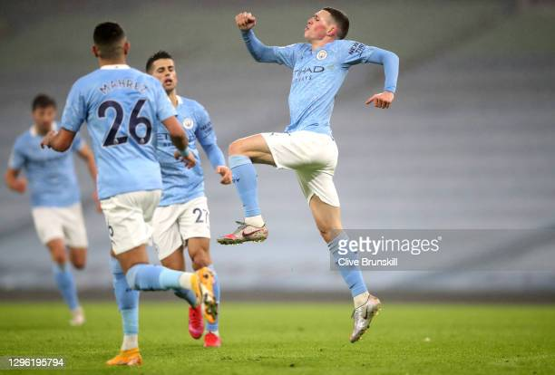 Phil Foden of Manchester City celebrates after scoring their team's first goal during the Premier League match between Manchester City and Brighton &...