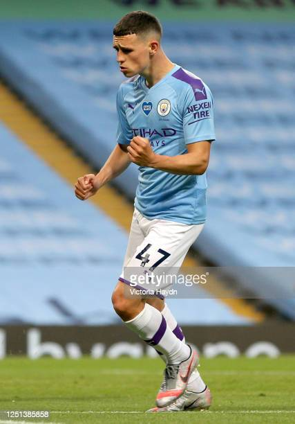Phil Foden of Manchester City celebrates his teams fifth goal during the Premier League match between Manchester City and Burnley FC at Etihad...