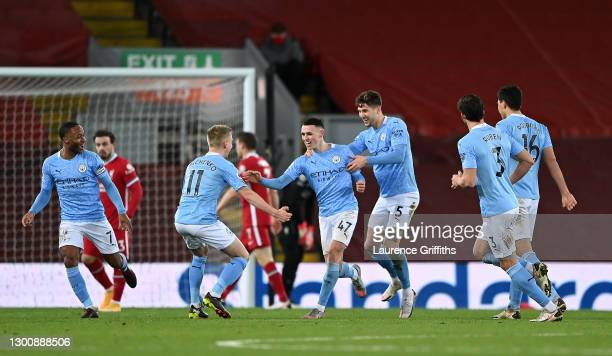 Phil Foden of Manchester City celebrates scoring the fourth goal with Oleksandr Zinchenko and John Stones during the Premier League match between...