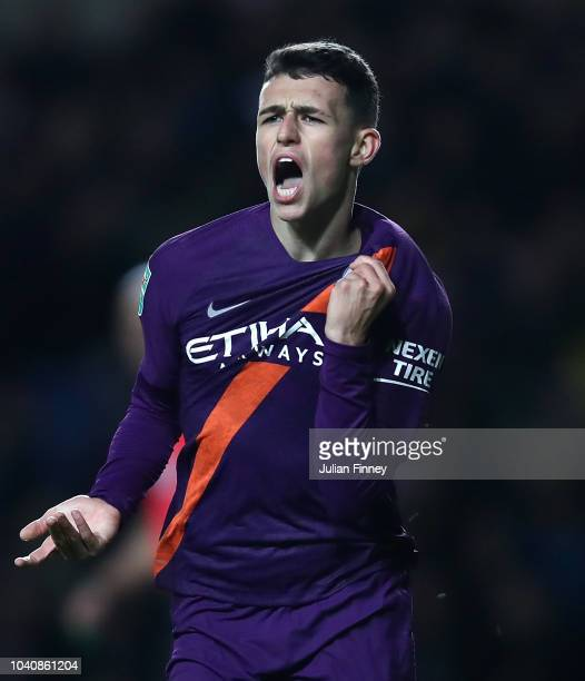 Phil Foden of Manchester City celebrates scoring their third goal during the Carabao Cup Third Round match between Oxford United and Manchester City...