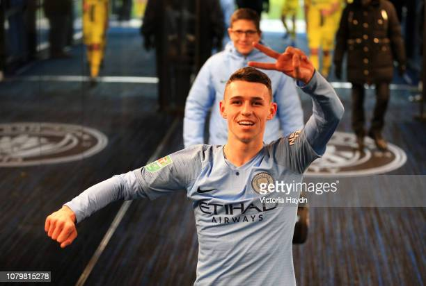 Phil Foden of Manchester City celebrates victory after the Carabao Cup Semi Final First Leg match between Manchester City and Burton Albion at Etihad...