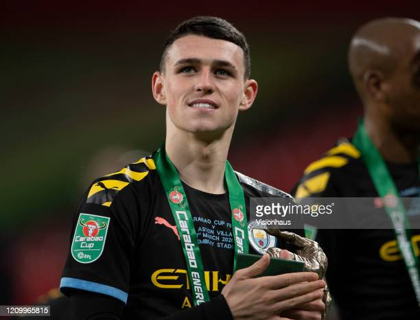 Phil Foden of Manchester City celebrates victory after the Carabao Cup Final between Aston Villa and Manchester City at Wembley Stadium on March 01...