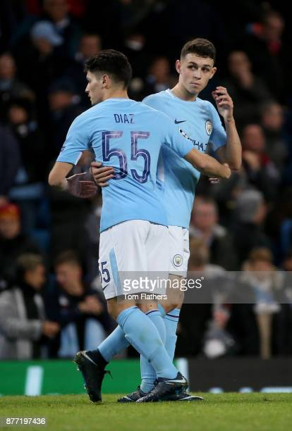 Phil Foden of Manchester City celebrates with Brahim Diaz after the UEFA Champions League group F match between Manchester City and Feyenoord at...