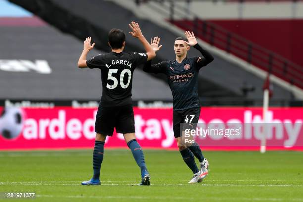 Phil Foden of Manchester City celebrates with Eric Garcia of Manchester City after scoring his sides 1st goal during the Premier League match between...