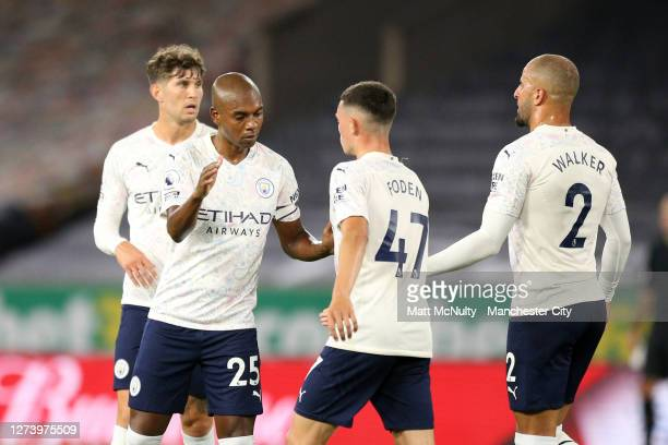 Phil Foden of Manchester City celebrates with Fernandinho and Kyle Walker after scoring his teams second goal during the Premier League match between...