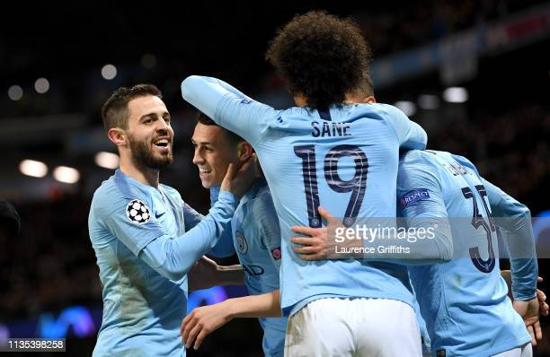 Phil Foden of Manchester City celebrates with his teammates after he scores his team's sixth goal during the UEFA Champions League Round of 16 Second...