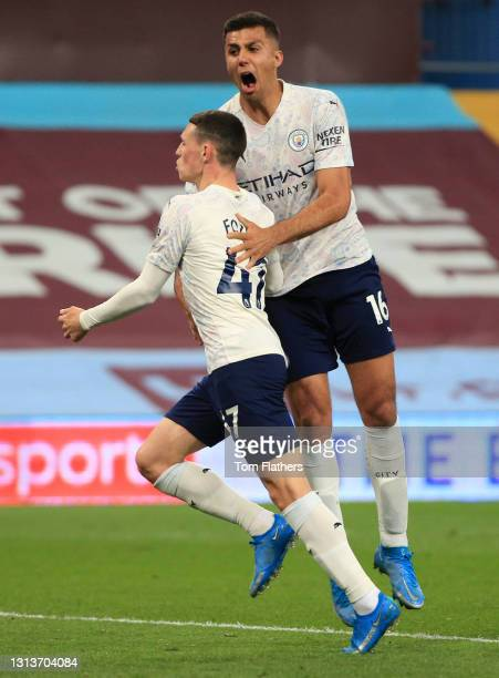 Phil Foden of Manchester City celebrates with Rodrigo after scoring their side's first goal during the Premier League match between Aston Villa and...