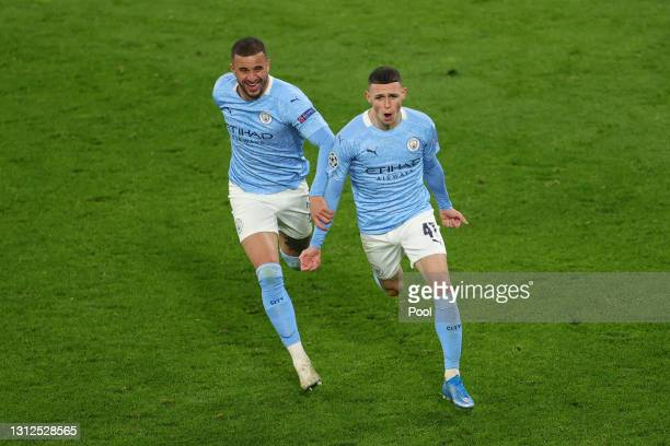 Phil Foden of Manchester City celebrates with team mate Kyle Walker after scoring their side's second goal during the UEFA Champions League Quarter...