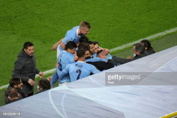 Phil Foden of Manchester City celebrates with team mates after scoring their side's second goal during the UEFA Champions League Quarter Final Second...