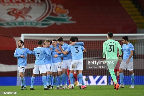 Phil Foden of Manchester City celebrates with team mates Bernardo Silva, Raheem Sterling, Oleksandr Zinchenko, John Stones and Ruben Dias after...