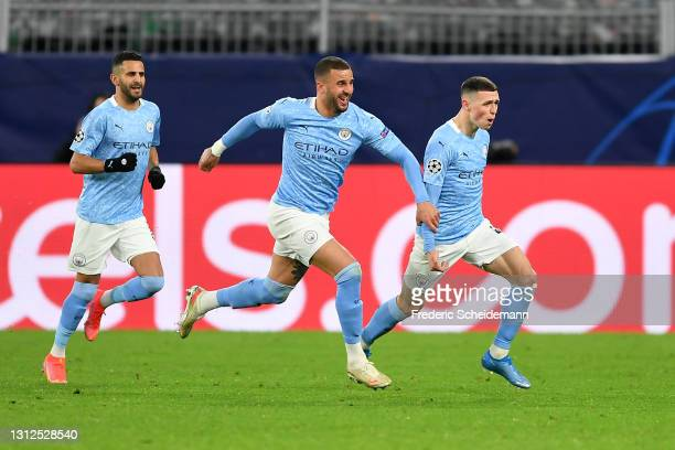 Phil Foden of Manchester City celebrates with team mates Riyad Mahrez and Kyle Walker after scoring their side's second goal during the UEFA...