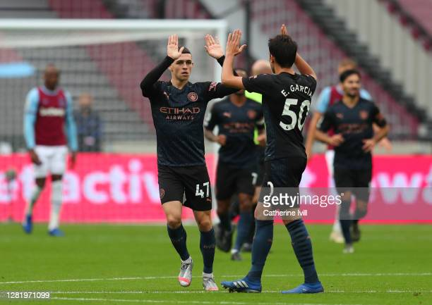 Phil Foden of Manchester City celebrates with teammate Eric Garcia after scoring his sides first goal during the Premier League match between West...