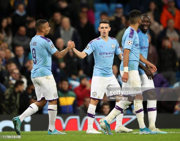 Phil Foden of Manchester City celebrates with teammate Gabriel Jesus after scoring his team's second goal during the UEFA Champions League group C...